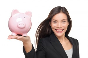 Businesswoman holding piggy bank - savings concept. Business wom